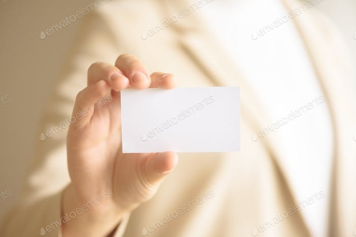 Businessman holding empty business card with copy space. Mock up. Business, study, network concept