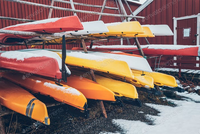 Kayaks in winter in Reine fishing village, Norway