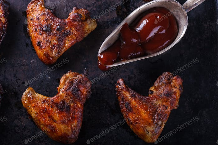 Chicken wings fried on the grill with BBQ sauce