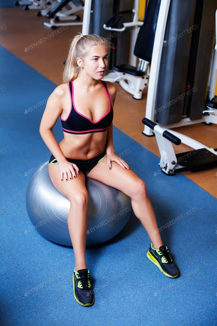 Girl exercising using rubber ball