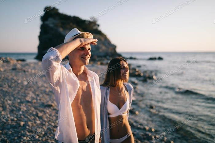Romantic couple in love enjoying vacation on beach at summer