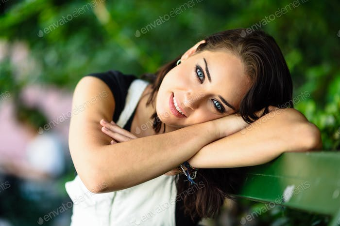Happy young woman with blue eyes looking at camera