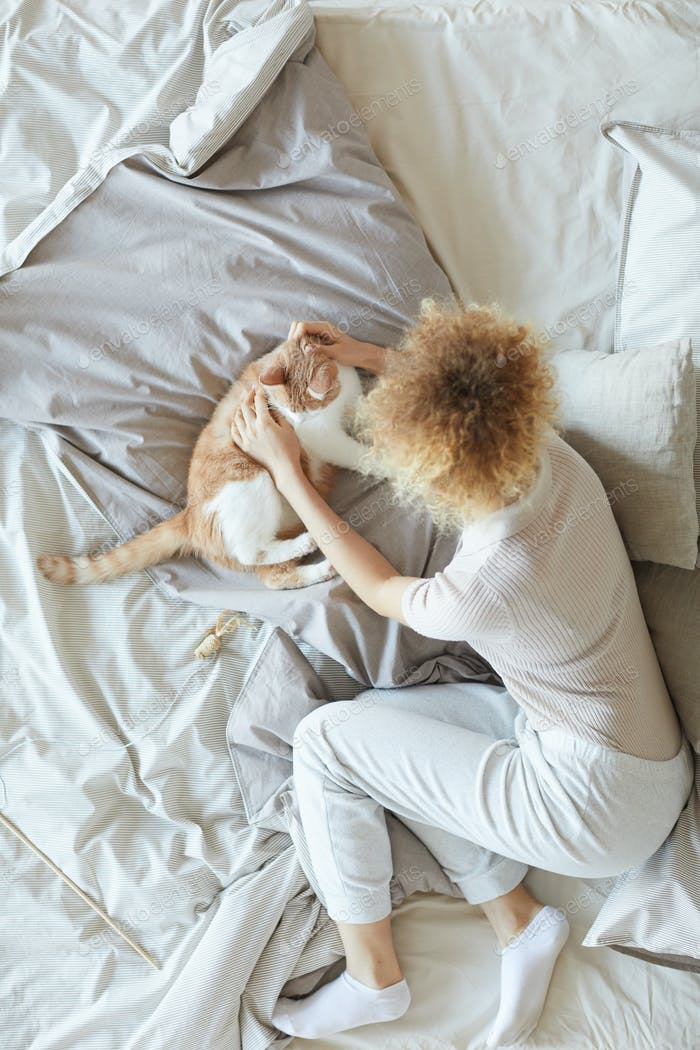 Girl with pet in the bed