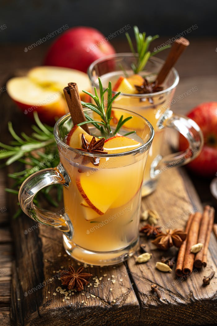 Christmas mulled apple cider with cinnamon and anise, traditional winter warming hot drink