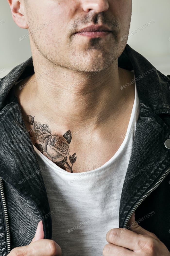 Close up of tattoo on the chest of a man