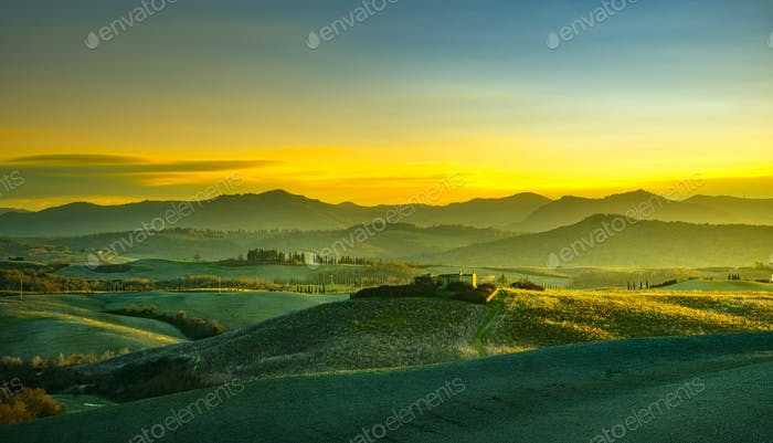 Volterra panorama, rolling hills and green fields at sunset. Tus