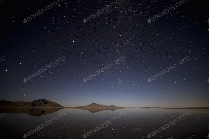 Flooded Bonneville Salt Flats at night, starry sky above