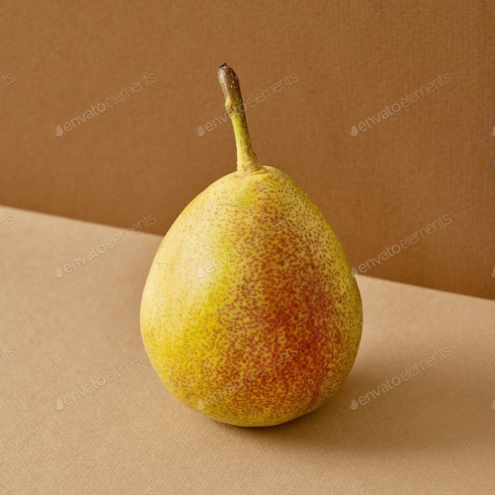 fresh pear on brown background