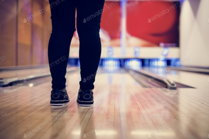 Standing in front of the bowling alley