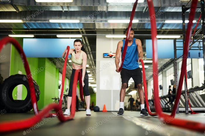 Fit Couple Working Out with Battle Ropes