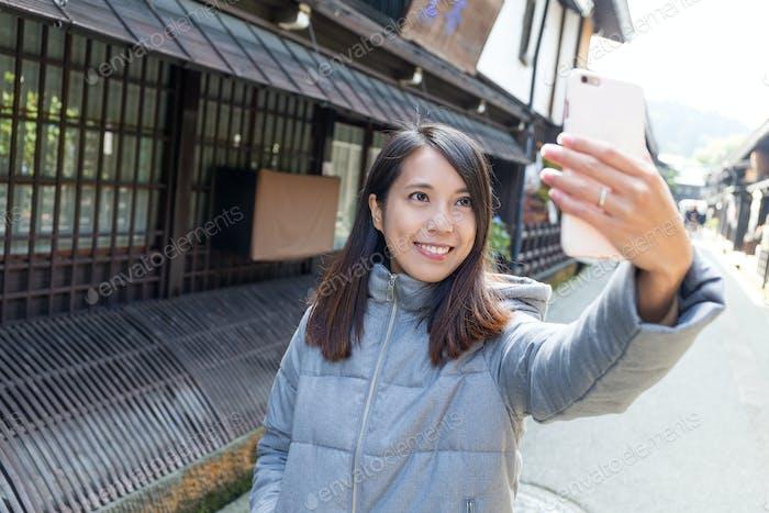 Woman traveler taking selfie in Takayama city