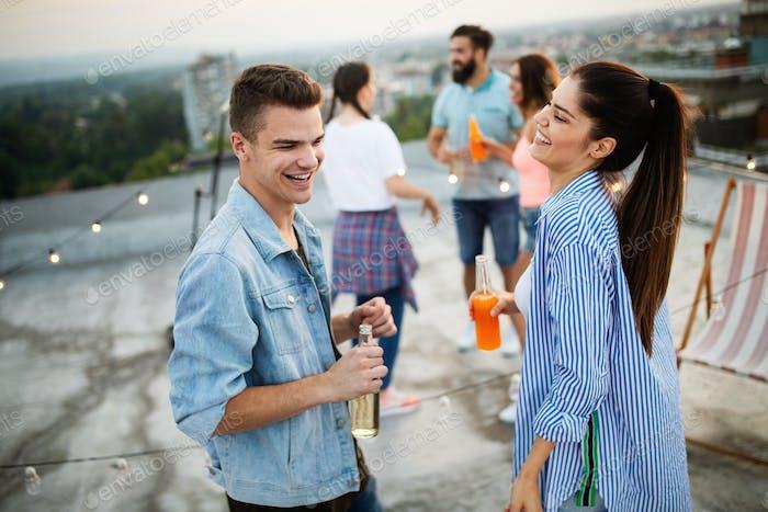 Thumbnail for Happy couple enjoying drinks and balcony party