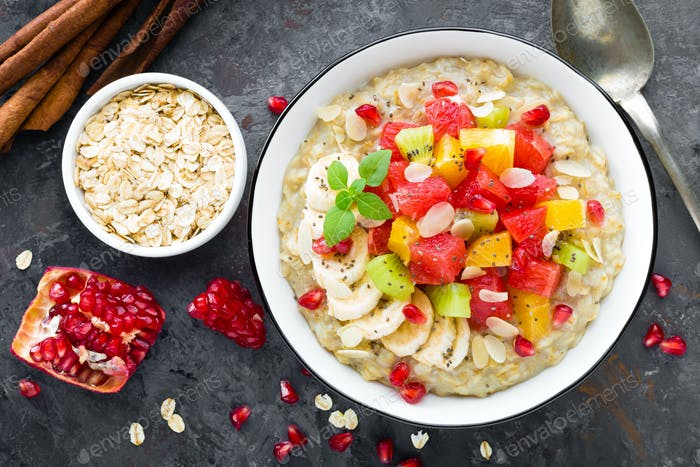 Oatmeal with fresh grapefruit, pomegranate, almond and chia seeds. Healthy breakfast