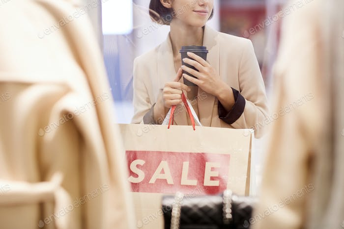 Girl Window Shopping in Mall