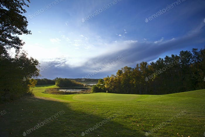 View up the fairway at a golf course.