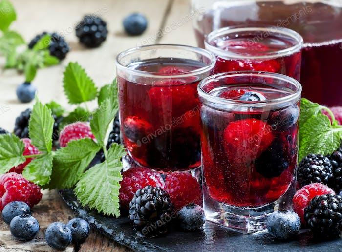 Fresh berry drink with blueberries, blackberries and raspberries
