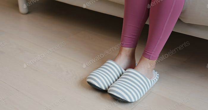 Woman wearing slipper at home
