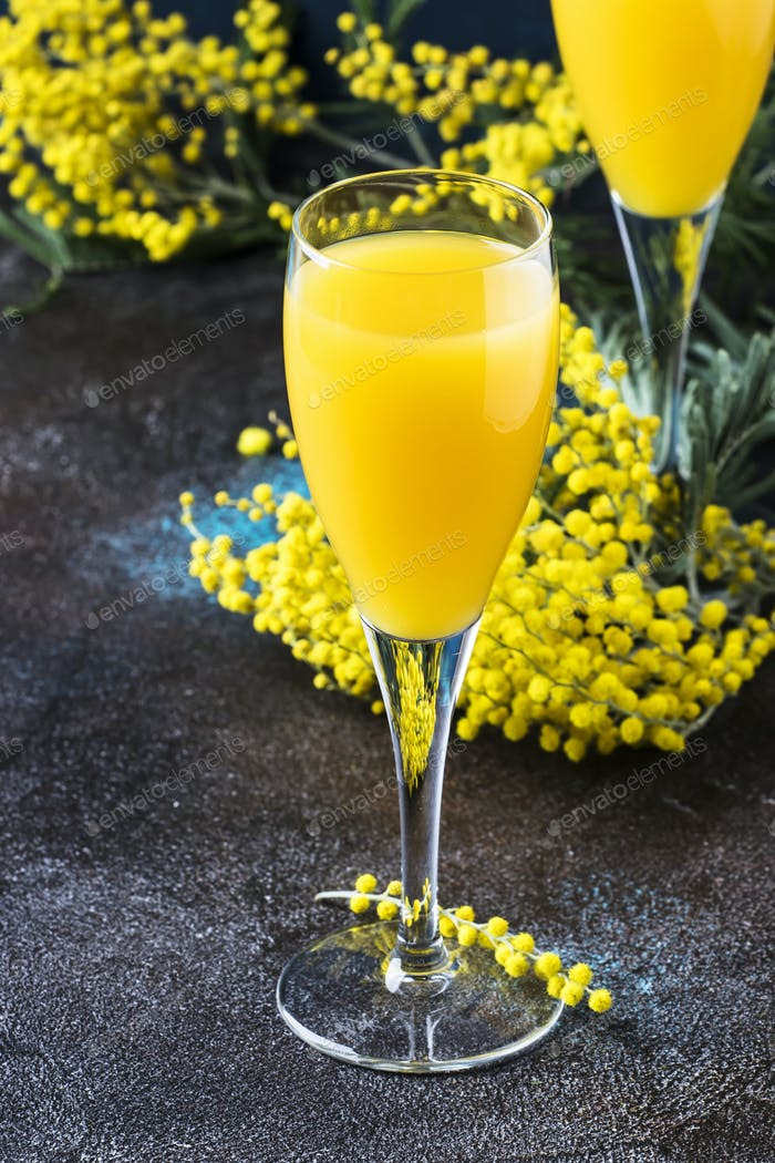 Low alcohol cocktail mimosa with orange juice and cold dry champagne
