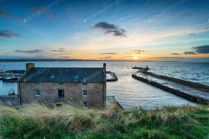Sunset over the harbour at Burghead