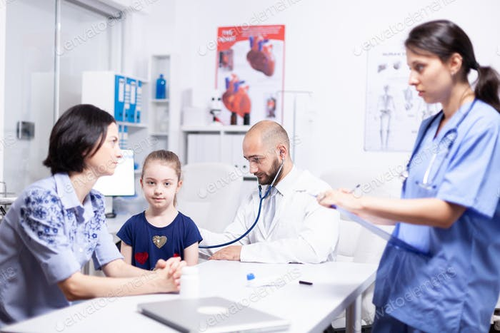 Pediatrician listening child breath