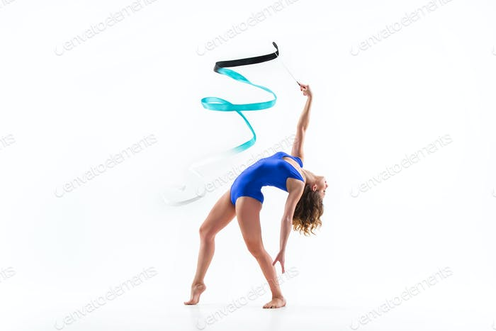 The portrait of beautiful woman gymnast on white