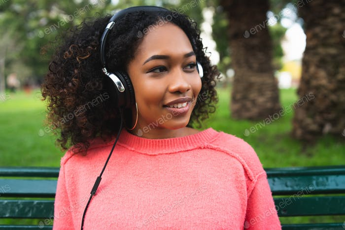 Afro american woman listening music