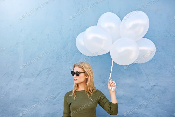 Trendy young female with balloons