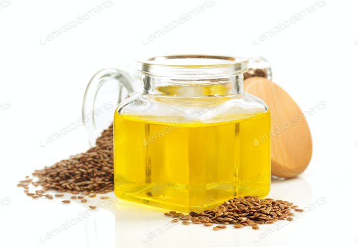 linseed oil in bottle isolated on white