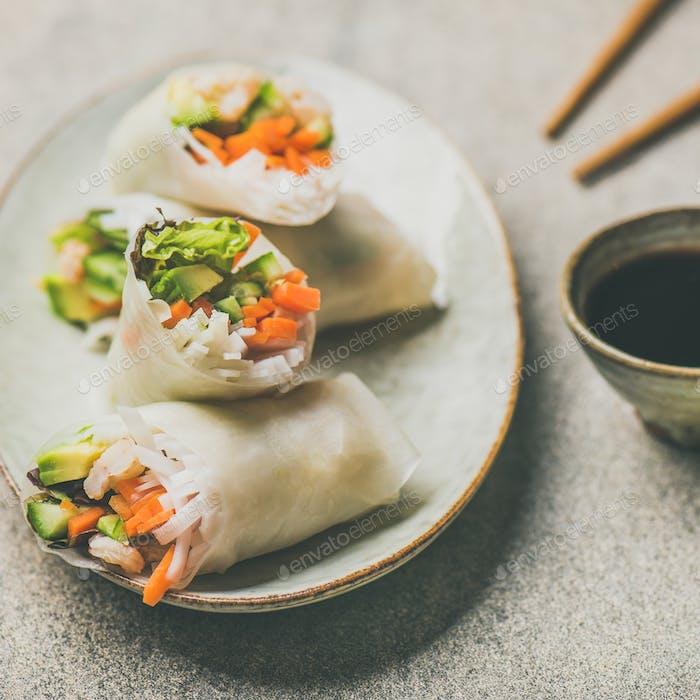 Shrimp and vegetable rice paper rolls, grey background, square crop
