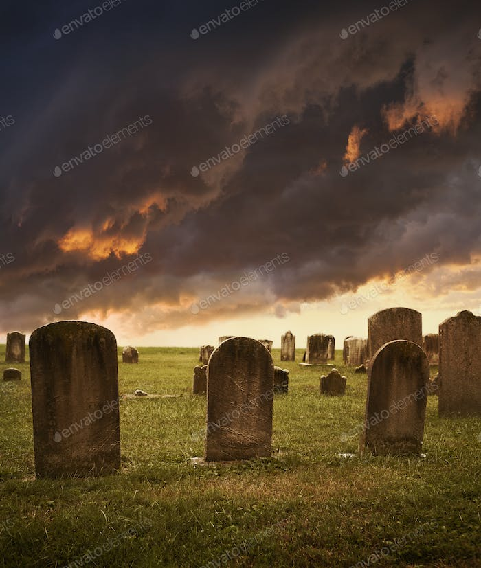 Spooky Halloween Cemetery Scene with Stormy Clouds