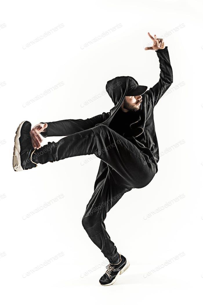 La silueta de Uno bailarín de hip hop masculino break dance sobre Fondo blanco