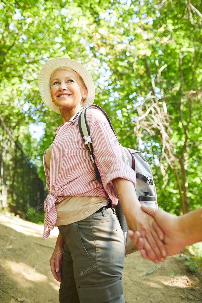 Mature woman hiking with man