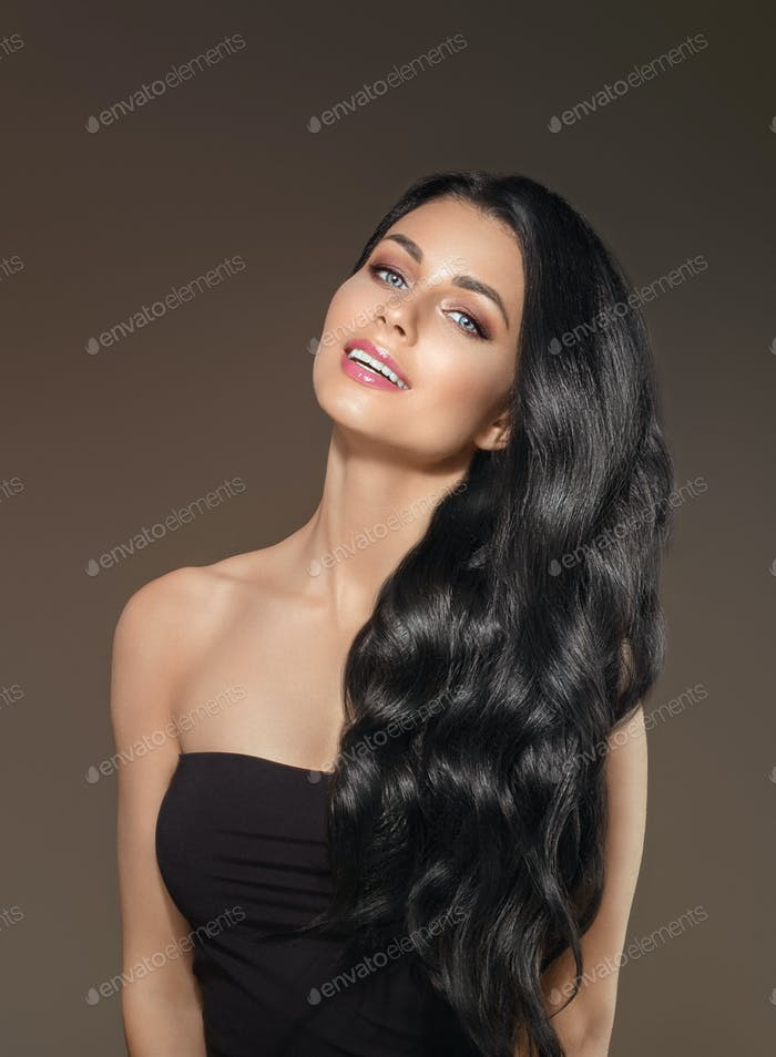 Woman with Black Long Hair and natural Make up over dark background