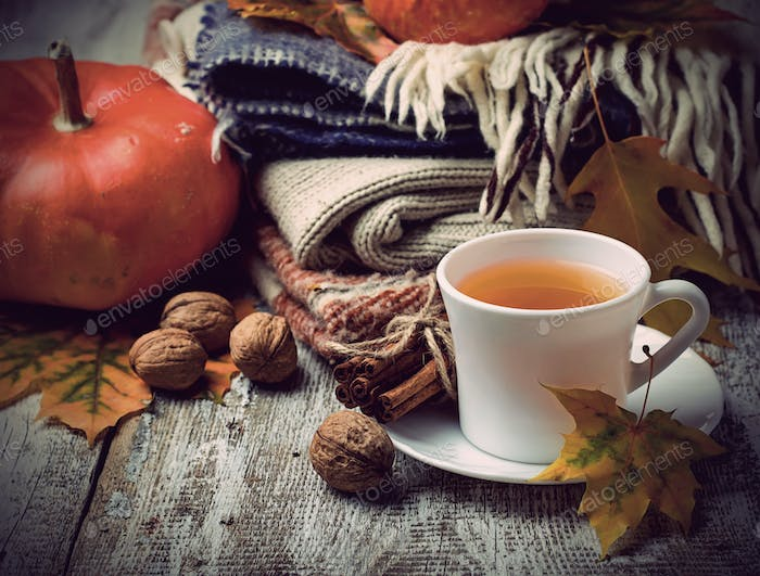 Autumn background with leaves, pumpkin and cup of  tea