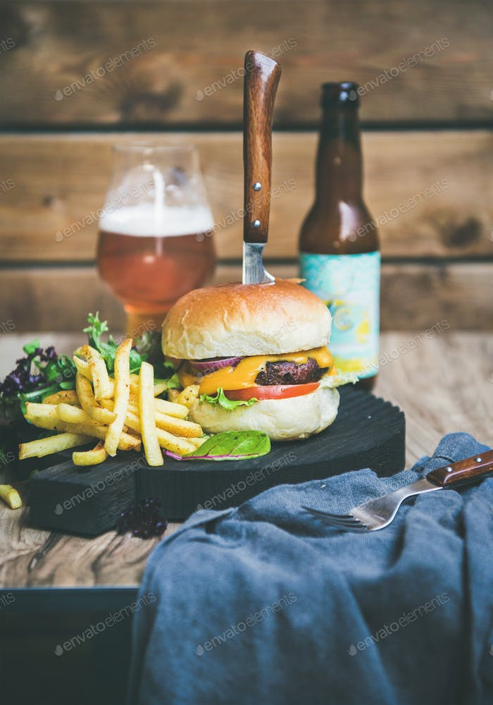 Classic burger dinner with beer and french fries, copy space