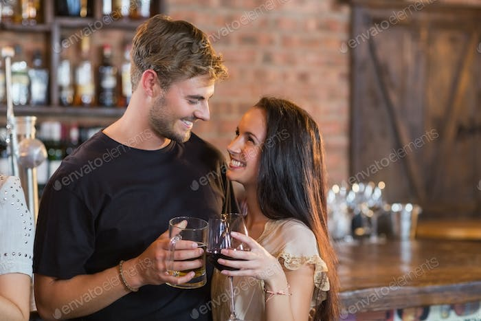 Smiling couple holding drinks