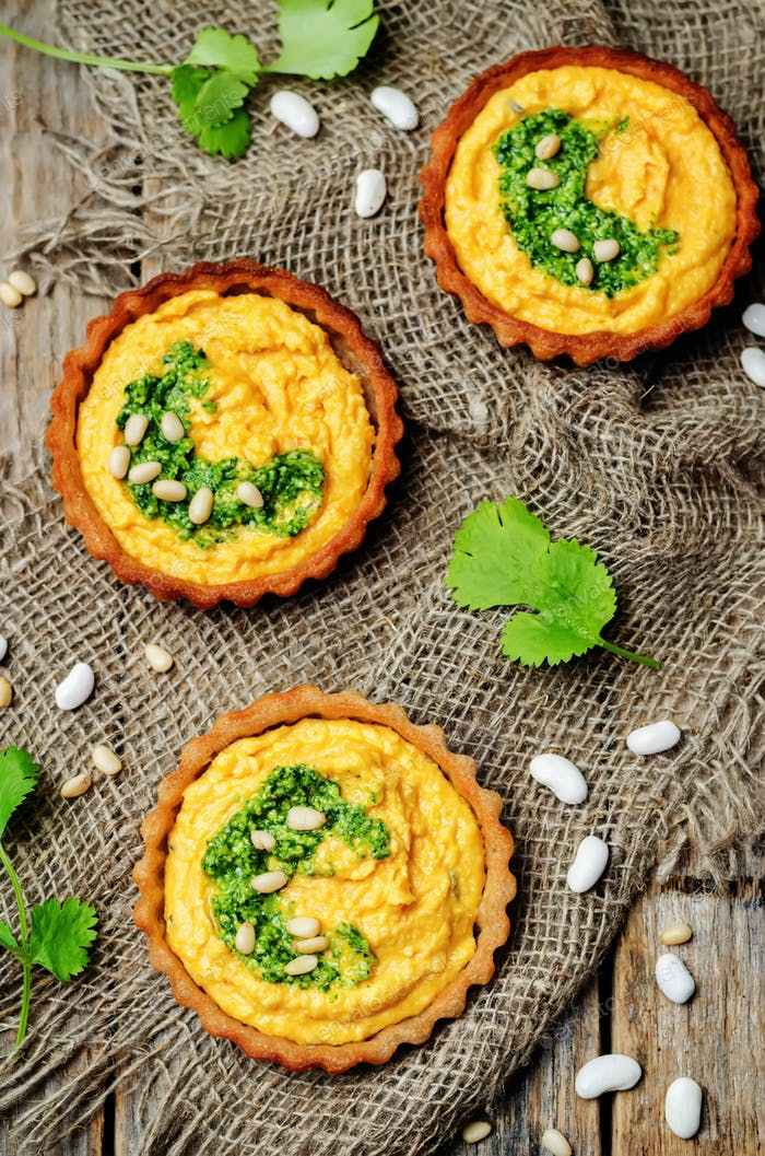 buckwheat tartlets with with white beans carrot hummus and cilan
