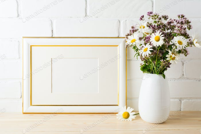 Gold decorated landscape frame mockup with blooming wildflower b