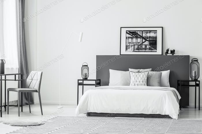 Spacious contrast bedroom interior