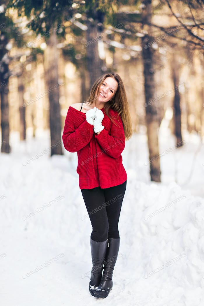 Winter portrait of young beautiful woman. Snow winter beauty cold fashion concept.