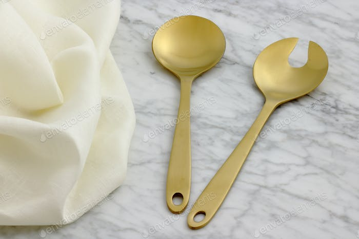 beautiful golden serving spoon and fork
