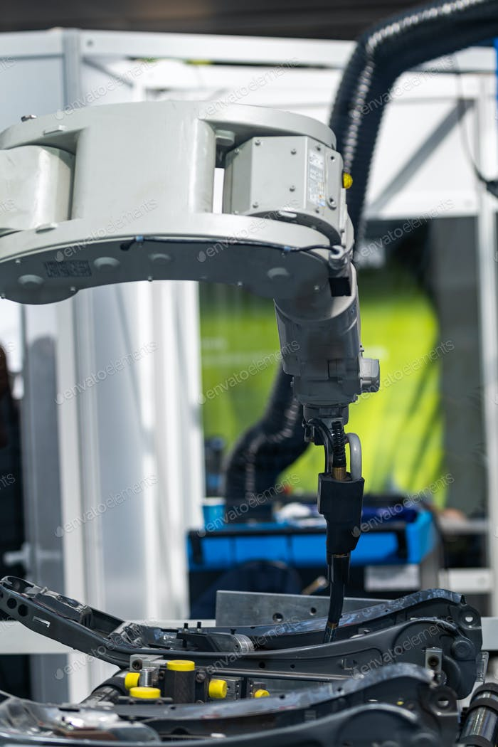 Robotic arm welding system in a manufacturing production plant