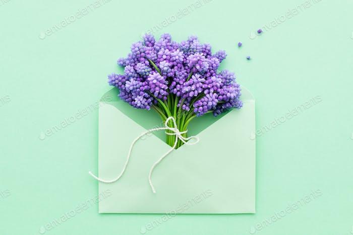 Flowers Bouquet Inside Turquoise Envelope.