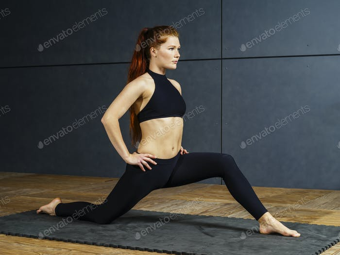 Beautiful redhead stretching her legs
