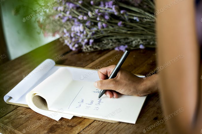 Adult Woman Hand Writing Order Note