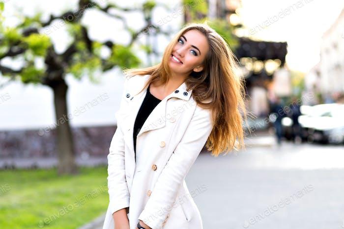 Blonde stunning woman walking alone at city center