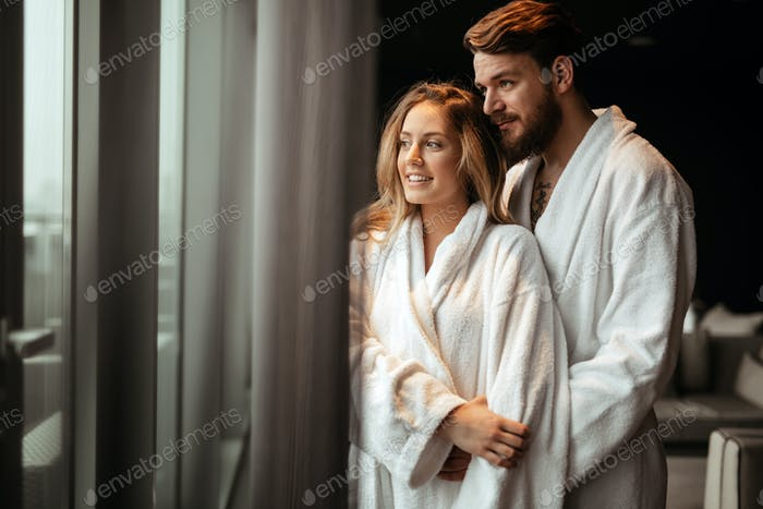 Couple relaxing in bathrobe