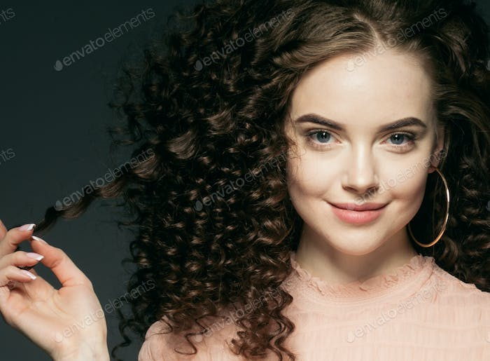 Curly hair woman beautiful face portrait