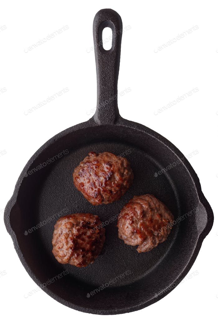Three fried meatballs on a frying pan