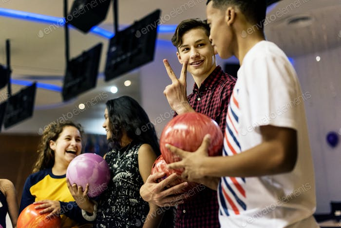 Friends bowling together after school